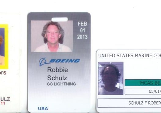 Badges include from left to righta: Contractor in the Naval Weapon Station, Boeing and the US Marine Corps Air Station